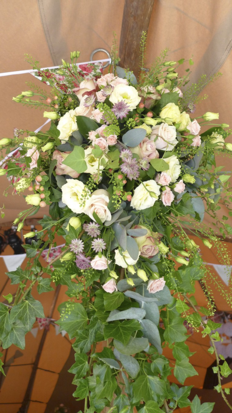 The entrance pole wedding  flowers, in old fashioned pinks and creams.