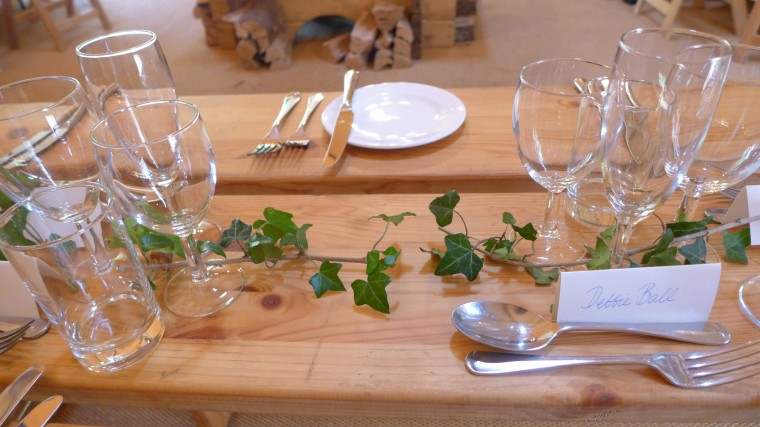 Trestle tables decorated with ivy.